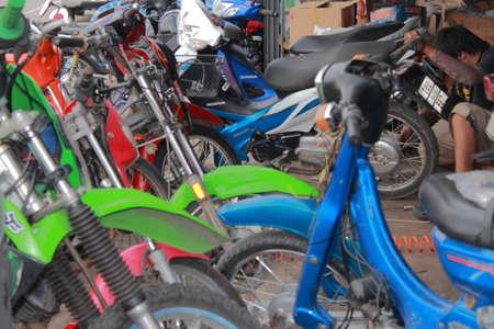 Chiang Mai Thailand - September 6 ,2012 : Repair motorcy in the Maerim Garage.