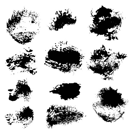 Abstract smears of black paint spots set on white paper