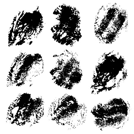 Texture smears of black dry paint spots on white paper