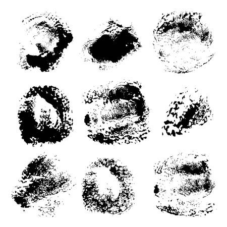 Texture smears of black paint spots set on white paper