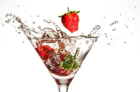 martini splash: Strawberries Dropping in Martini Glass