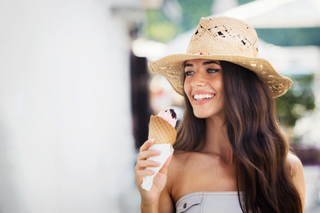 Summer portrait of beautiful woman with ice cream outdoors Stock Photo