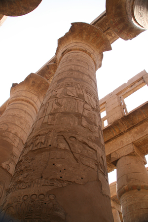 Hieroglyphic covered columns in the Hypostyle Hall. Karnak Temple, Luxor, Egypt Stock Photo