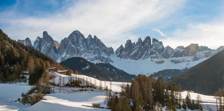 odle: Odle mountains in winter, blue sky with clouds, Dolomites, Italy