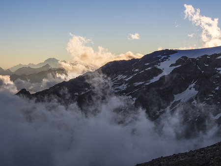 aosta: Alpine peaks in the clouds seen from Mantova hut on Monte Rosa, Aosta Valley, Italy