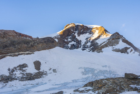 pyramid peak: Vincent Pyramid peak and Gnifetti mountain hut at sunset, Monte Rosa, Alps, Italy Stock Photo
