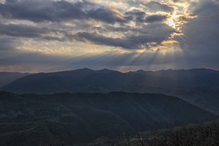 apennines: Rays of light in the clouds after a storm, Apennines, Umbria, Italy Stock Photo