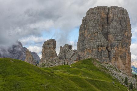 torri: Cinque Torri mountain range in Summer, blue sky with clouds, Dolomites, Veneto, Italy Stock Photo