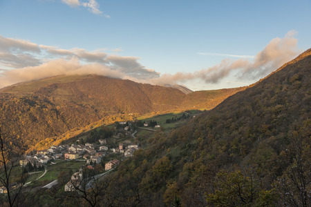apennines: Sunrise on a small old town on mount Strega in Autumn, blue sky with clouds, Apennines, Marche, Italy