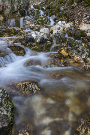 np: Waterfall in autumn in the forest, mount Cucco NP, Umbria, Italy Stock Photo