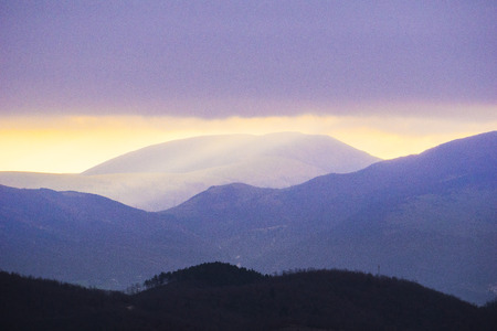 apennines: Rays of light on mount Cucco after a storm, mount Cucco NP, Apennines, Umbria, Italy Stock Photo