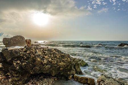 np: Black rocks beach at sunrise NP Conero Marche Italy Stock Photo