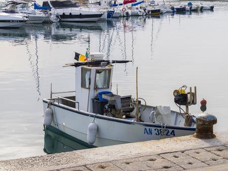 marche: Fishermans boat at the harbor, Numana, Conero, Marche, Italy Editorial