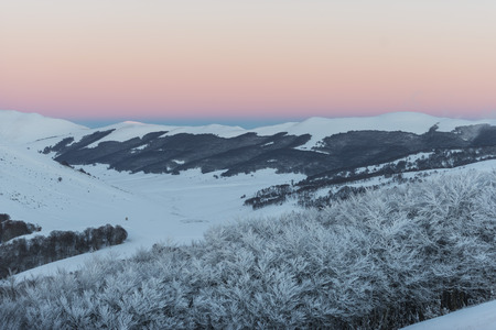 sibillini: Sunset on the mountains in winter with snow, Sibillini mountains NP, Umbria, Italy