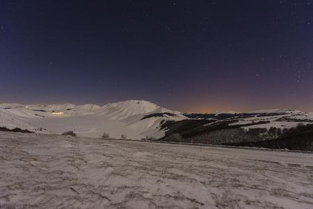 castelluccio: Piano Grande of Castelluccio di Norcia in winter with snow by night, Sibillini mountains NP, Umbria, Italy
