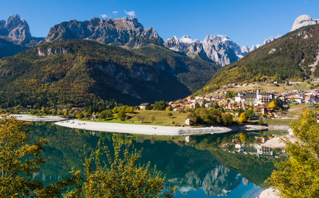 Molveno Lake: scenic view of resort by picturesque lake in Alpine mountains Stock Photo
