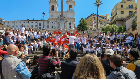 Rome, May 9, 2014 - Flash mob I love EU . Minister Stefania Giannini on the steps of Piazza di Spagna with dozens of kids to celebrate Europe Editorial