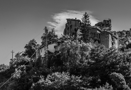 chronicle: Arquata del Trontos medieval village destroyed by the earthquake of august 24, 2016 in Italy. Black and white photography.
