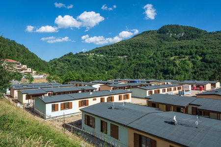 chronicle: Prefabricated houses built after the earthquake that struck the town of Arquata del Tronto on August 24, 2016 in Italy, Lazio.Arquata del Trontos medieval village destroyed by the earthquake Stock Photo