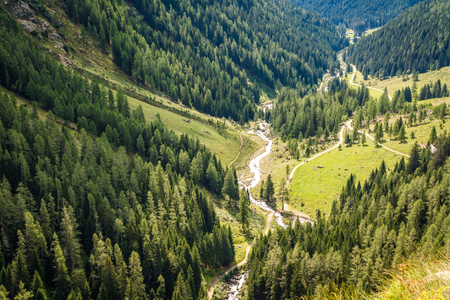 curve road: waterfall mountain landscape. Rabbi Valley, Trentino Alto Adige, northern Italy Stock Photo