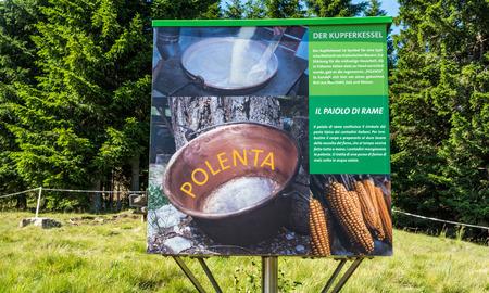 billboard dedicated to polenta recipe. Mountain symbol and South Tyrolean tradition. South Tyrol, Trentino Alto Adige, Bolzano, northern Italy