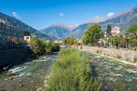 Merano in South Tyrol, a beautiful city of Trentino Alto Adige, View on the famous promenade along the Passirio river. Northern Italy.