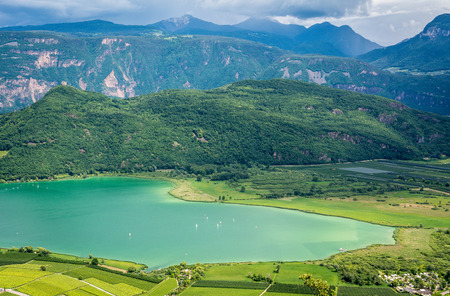 Lake Caldaro along the South Tyrolean Wine Route is the warmest bathing lake in the Alps. Trentino Alto Adige, Northern Italy