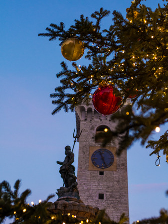 Christmas in Trento, a charming old town with the Christmas lights. Urban night scene. Editorial