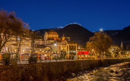 Meran Merano in South Tyrol, Italy, during the Christmas with christmans market by night . Beautiful light and great atmosphere Stock Photo