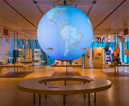 TRENTO, Italy, june 2017: The interior of the famous Museum of the Sciences of Trento in Trentino Alto Adige. The large interactive globe that shows the real situation