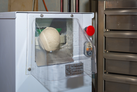 Commercial pizza dough rounder for a best dough preparation before moulding Stock Photo