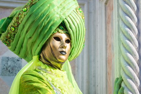Beautiful green mask at the Venice Carnival
