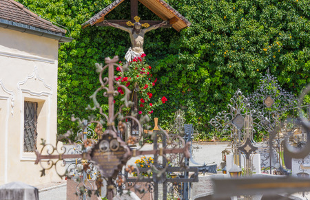 Bolzano, Varna in South Tyrol, Italy, may 25, 2017: small cemetery located at the Augustinian Canons Regular monastery Abbazia di Novacella localed in Varna, Bolzano in South Tyrol, northern Italy