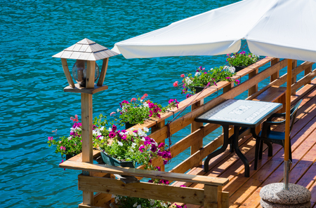 romantic terrace on Lake Alleghe, Belluno, Italy: an fascinating lake , in the geographic heart of the Dolomites UNESCO World Natural Heritage Stock Photo