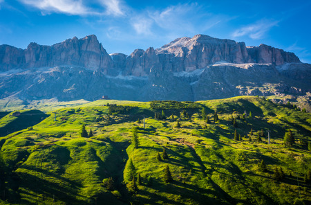 mountain landscape in summer and the dark blue sky with clouds in Trentino Alto Adige. View from Passo Rolle, Italian Dolomites, Trento, Italy.