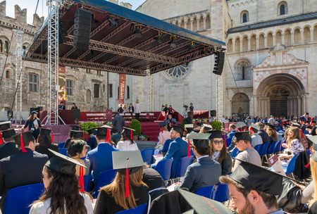 the graduation ceremony in the main square of the city of Trento. The city is famous for the prestigious universities. Stock Photo - 96186513
