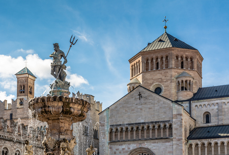 Trento city: main square Piazza Duomo, with clock tower and the Late Baroque Fountain of Neptune. City in Trentino Alto Adige, northern Italy, Europe