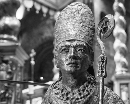 TRENTO, Italy - february 21, 2018: bronze statue of San Vigilio, patron of trento, in the Cathedral of San Vigilio or Cathedral of Trento, Trentino Alto Adige, Italy. Image in black and white. Editorial