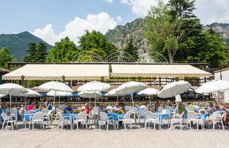 Lakefront cafe on the beach in Limone sul Garda, Lake Garda, Lombardy, Italy Editorial
