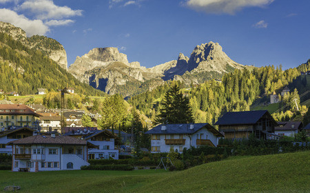 autumn landscape in Gardena Valley. The town of Santa Cristina (St. Christina in Groden) with the light of the sunset, located in the heart of Dolomites,  South Tyrol, Italy