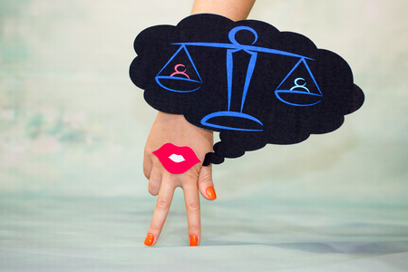 Female hand with two fingers down smile and red lips on a blue background and regional thoughts