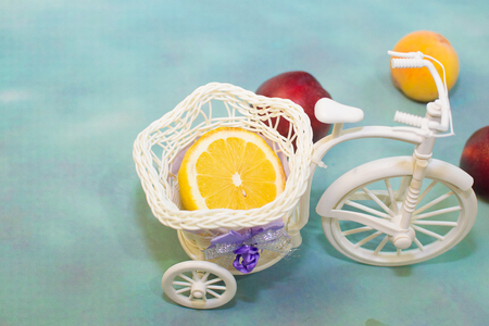 with sliced lemon in a decorative bike with the fruit brought on a blue background