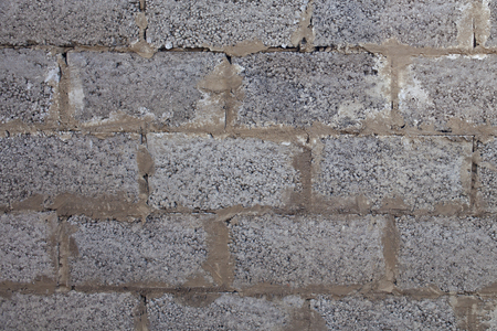 Old wall made of expanded clay blocks for background and design. Grunge texture. 스톡 콘텐츠