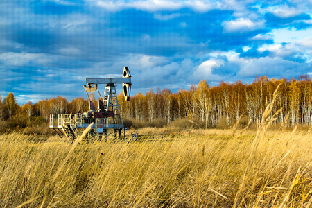 oil rocking in the field in the fall. Russia. republic of bashkortostan. Rosneft, Bashneft, background of blue sky in the summer