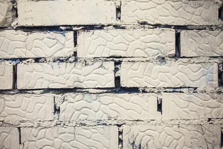 mur de briques peint en blanc texture