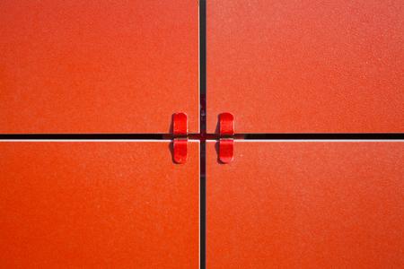 Arrangement of ventilated facade. Red ceramic tiles for the facade. Construction technology Stock Photo
