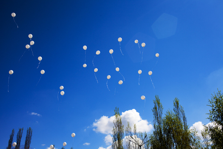 White balloons in the sky. The concept of peace. Russia Banco de Imagens