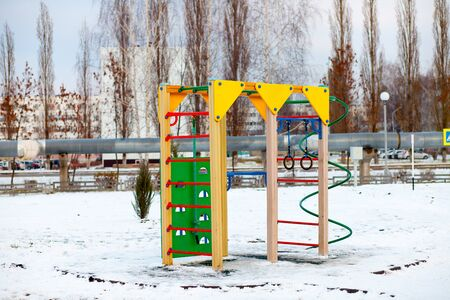 A childrens playground, a slider located on the sand. Sunny winter day