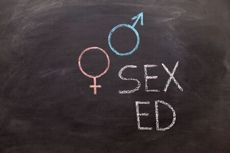 School blackboard with text SEX ED