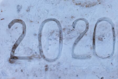 New year 2020 text on fresh white snow